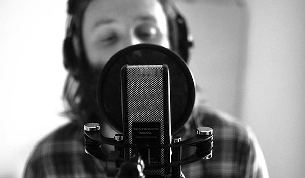 singing teacher ian preston recording in the studio