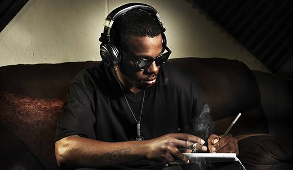 soul singer writing lyrics in the studio