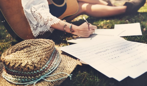 Folk Singer in the park writing a song